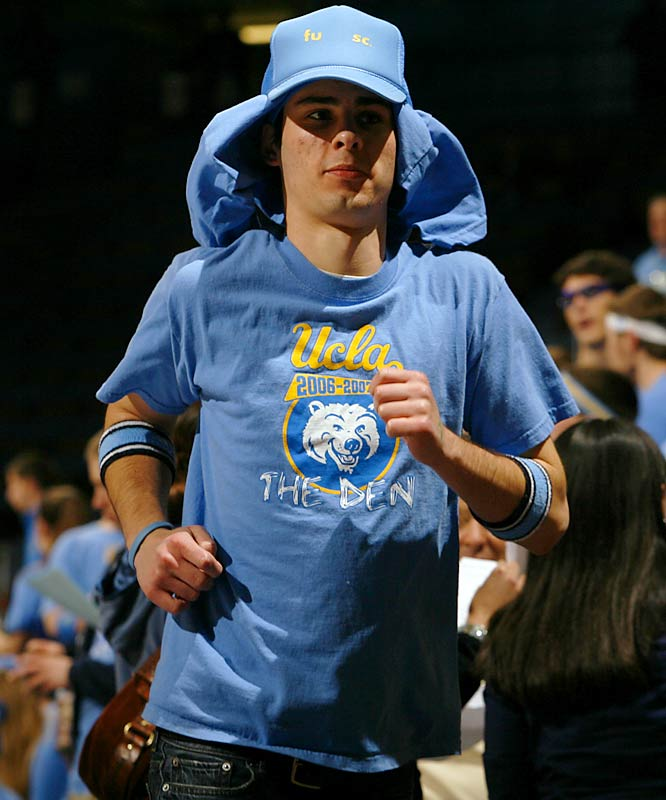 A UCLA student shows decent hustle as he rushes to his seat.
