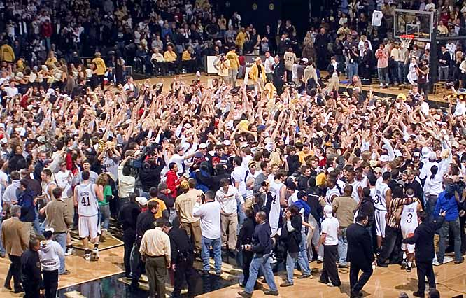 Vanderbilt fans storm the court to celebrate the upset over Florida. The celebration cost the school $25,000 in fines.