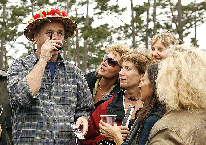 Bill Murray enjoys a beverage during his round.