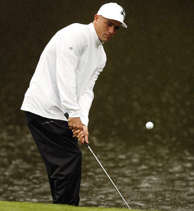Surfer Kelly Slater is all business while on the course.