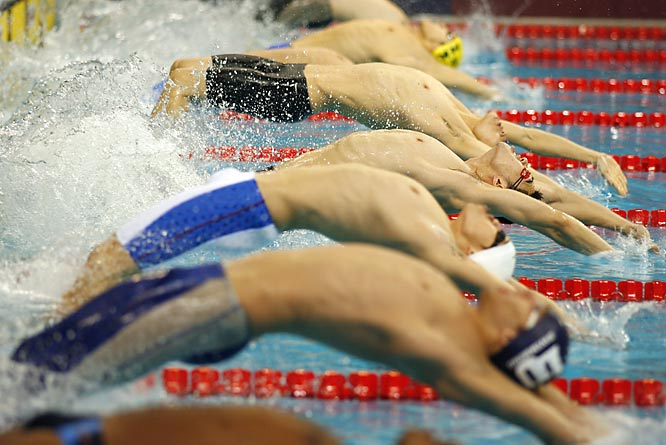 China's Bodang Zhang (red goggles) during the second heat of the men's 50-meter backstroke.