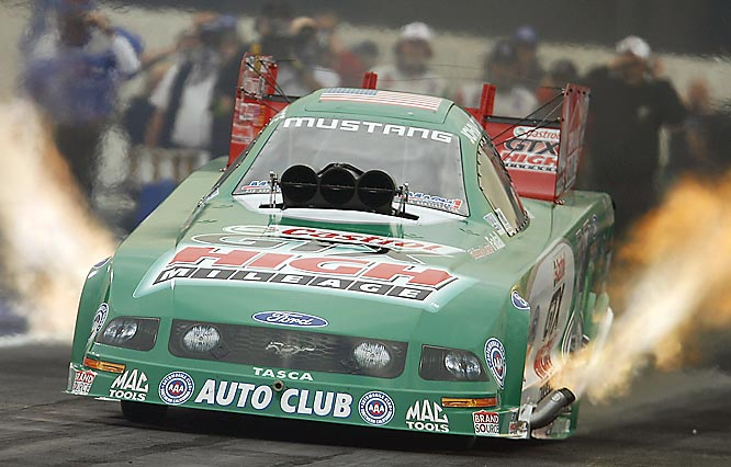 John Force is the winningest driver in NHRA history, with 122 career wins and 14 Funny Car titles. He's also a huge fan favorite. After winning the 2006 title, Force celebrated by giving a Funny Car ride to his daughter Ashley, who is a star in the making.