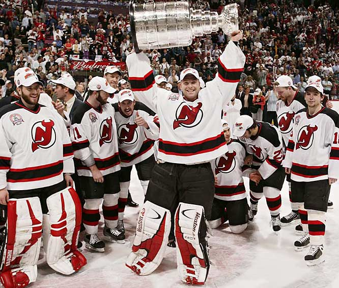 "Klutho's take: <br><br>""This was the 2003 Stanley Cup. I like it because it's not really posed. Your interest is directed to him because he's facing the camera and no one else is. It's not like a bunch of people mugging for the camera, it's just Brodeur enjoying the moment.""<br><br> Shot with a Canon EOS-1DS"