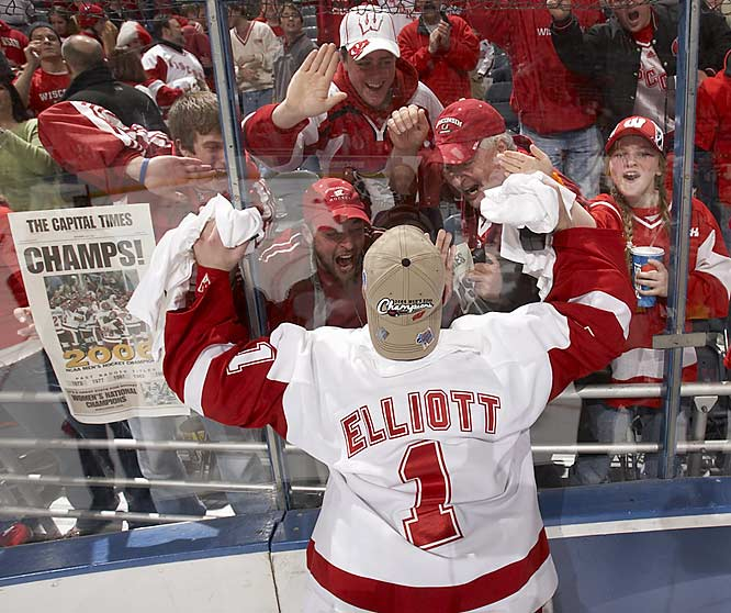 "Klutho's take:<br><br>""He's connecting with the fans after the Badgers won it all last season. Everybody's trying to give him a high-five through the glass. It's a great scene.""<br><br> Shot with a Canon EOS-1D Mark II N"