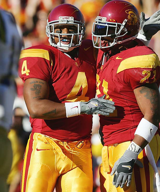 Lewis (left) signed with USC out of high school, but injuries, academic issues and steep competition limited his success at USC. He transferred to Northern Iowa prior to the 2006 season but appeared in only seven games for the Panthers. He rushed for 360 yards and three touchdowns on 80 carries.