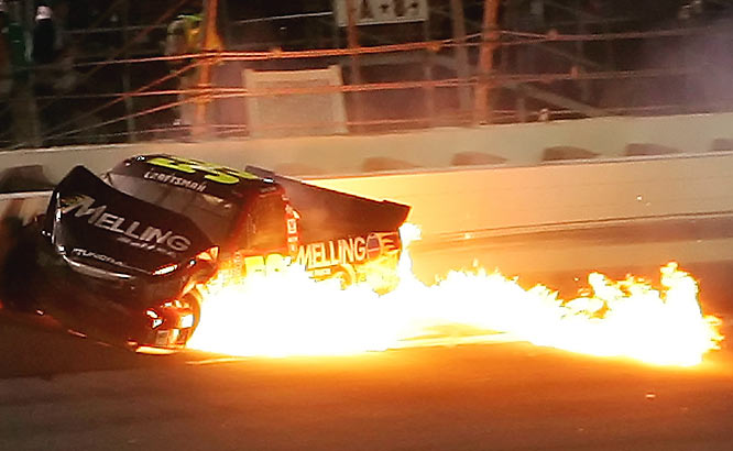 Terry Cook's truck catches on fire after a crash during the Chevy Silverado HD 250.