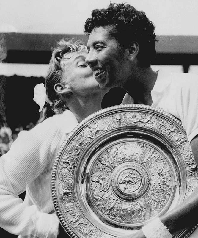 Althea Gibson won Wimbledon and became the first African-American crowned champion at the All-England Club. After her victory in England, Gibson returned stateside to win the U.S. Championships at Forest Hills. New York honored her with a ticker-tape parade down its Canyon of Heroes.