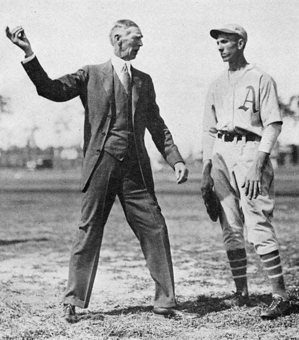 Connie Mack (left) shows a Philadelphia Athletics rookie the finer points of pitching at spring training in Lake Charles, La.