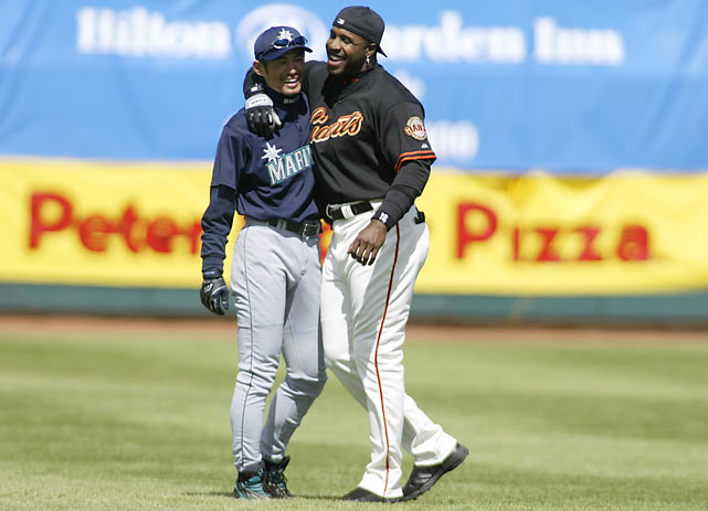 Ichiro and Barry Bonds share a moment during a spring training game in Scottsdale, Ariz.