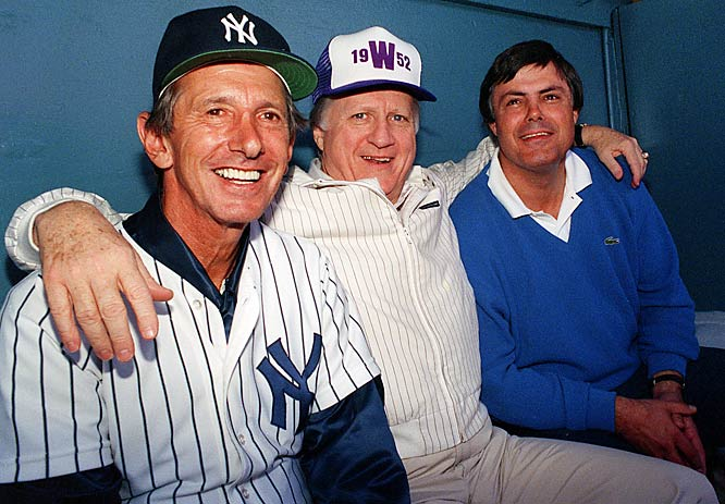 George Steinbrenner is flanked by five-time manager Billy Martin and vice president and general manager Lou Piniella at spring training. Steinbrenner would replace the two during the season.