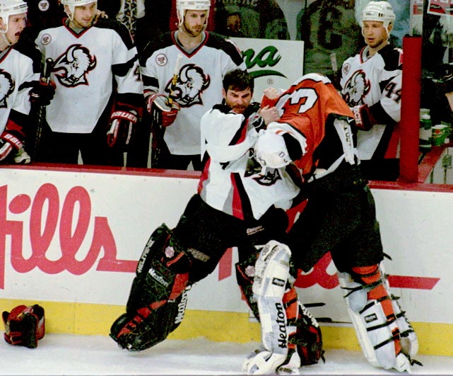 While the Flyers and Sabres engaged in a Pier Sixer, Shields would not be denied a chunk of Snow. The linesman soon found himself part of a roiling threesome that eventually looked like bags of laundry wrasslin' against the boards. Click here to watch the fight!