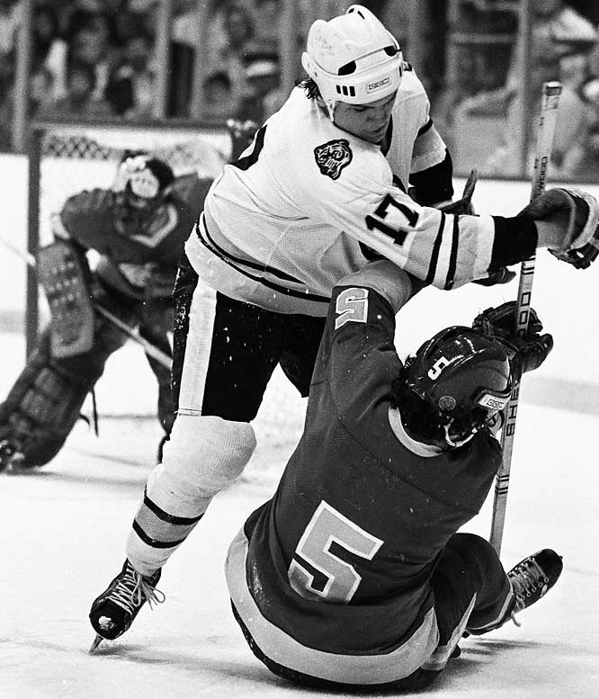 A diminutive (5-8, 175-pound) wrecking ball, Jonathan was a favorite of coach Don Cherry and Bruins fans for six seasons (1976-82). He was a fearless checker and hellacious fighter, often taking on such heavyweights as Dave Schultz and Moose Dupont, and winning. His most hair-raising bout was against Montreal's Pierre Bouchard on May 21, 1978. The link below is not for the faint of heart.
