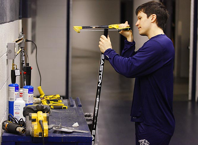 Saturday 9:10AM<br> Left wing Paul Kariya starts game day by carefully preparing his sticks.