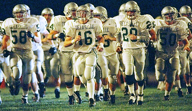 De La Salle blew past the record for the longest unbeaten streak in high school football... and then kept winning for another six years. The Spartans' record, which began in 1992, finally concluded in 2004 after 151 consecutive victories. During the streak, De La Salle beat nine nationally ranked opponents and was named USA Today's national champion five times. The Spartans were also named the top team in California for all but one year of the streak. Current and former NFL players Maurice Jones-Drew, T.J. Ward, Matt Gutierrez, D.J. Williams, David Loverne and Derek Landri all played for De La Salle during the undefeated stretch.