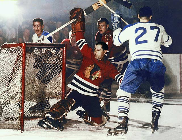 Hall made 502 consecutive starts in goal. When you include his minor league, All-Star and playoff games beginning in 1951, the Hall of Fame netminder played a staggering, mind-boggling total of 881 straight games until 1962, covering seven full NHL (with Chicago and Detroit) and 11 pro hockey seasons. And Hall played them all without a mask, facing slap shots, frequently being run over by opposing skaters, and suffering a few pretty serious injuries, including getting hit in the mouth by a puck during the 1957 playoffs, losing some teeth and still continuing to man the Red Wings' net.