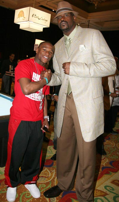 Shaq, whose jacket is as big as boxer Floyd Mayweather Jr, looks ready for All-Star Weekend.