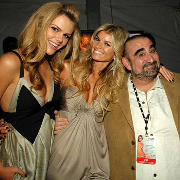 Things are looking up for Ken Davitian, the actor who played the sidekick in Borat. Last we saw him, he was naked and, um, tangled up with Borat. Now he's attending the SI Swimsuit Party and hanging with Brooklyn Decker (left) and Marisa Miller.