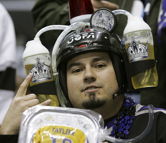 Most stadiums won't let you bring in food, but we guess a beer helmet is OK.