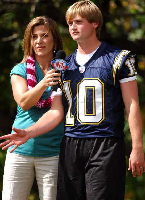 The NFL Network's Kara Henderson interviews a junior high school football fan. Oh, our bad. That's Chargers kicker Nate Kaeding.