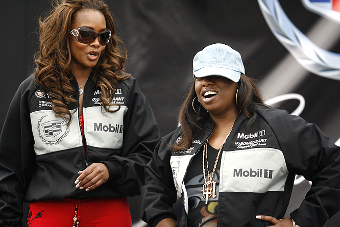 Vivica A. Fox (left) and Missy Elliot chat before the race.