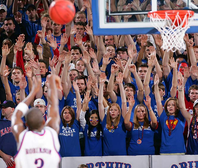 Jayhawk fans raise their arms in unison during Saturday's victory over Texas.