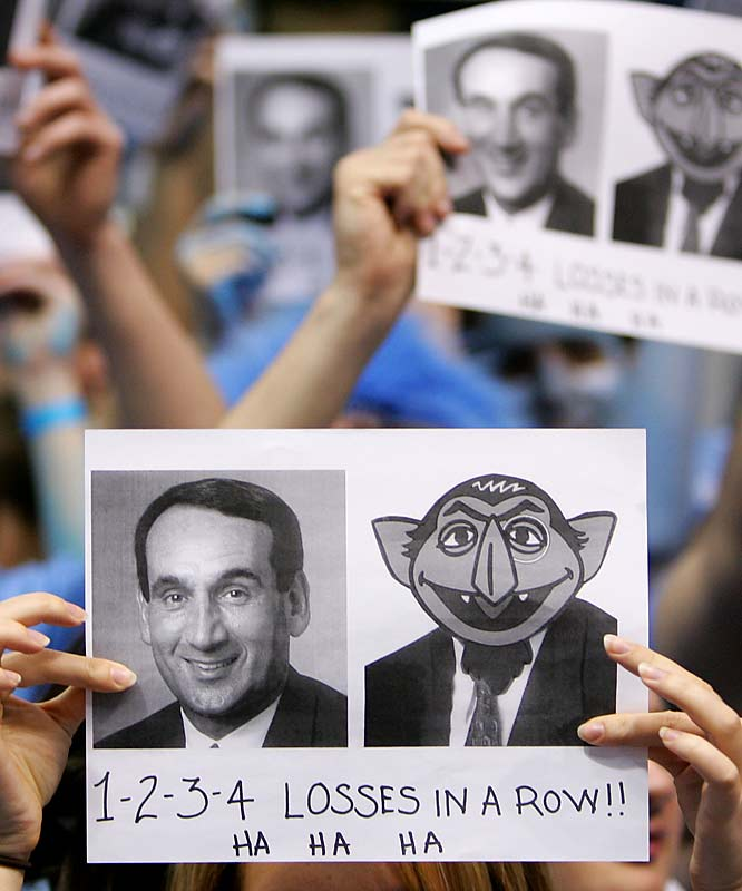 UNC fans heckle Duke head coach Mike Krzyzewski during Sunday's matchup between the two ACC rivals.