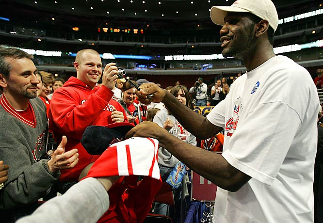 Ohio State's Greg Oden signs autographs for fans following the Buckeyes 66-49 victory over Wisconsin in the finals of the Big Ten tournament.
