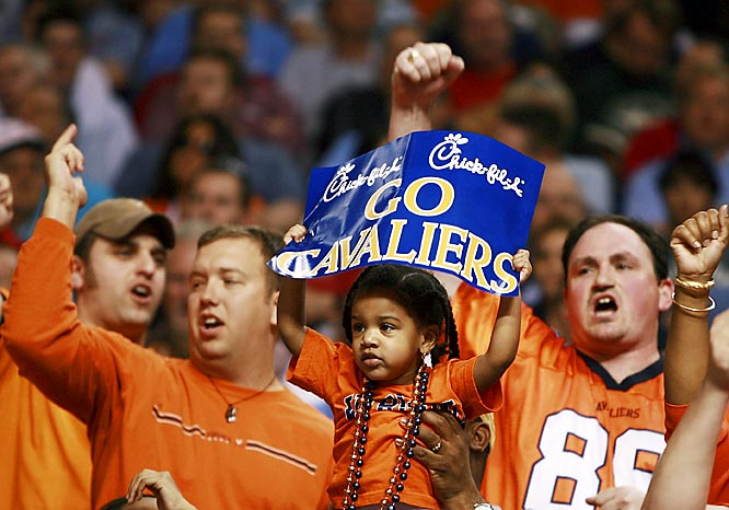 Virginia fans of all ages show their support for the Cavaliers during their matchup with NC State in the quarterfinals of the ACC Tournament in Tampa, Florida.