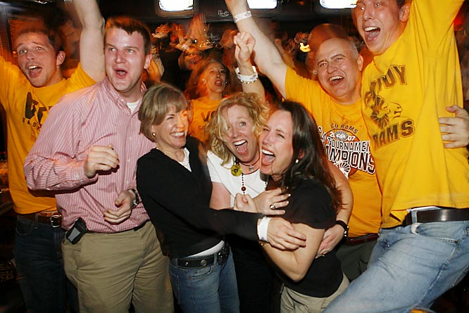 Virginia Commonwealth fans celebrate while watching a television broadcast of the Rams' first-round upset over Duke.