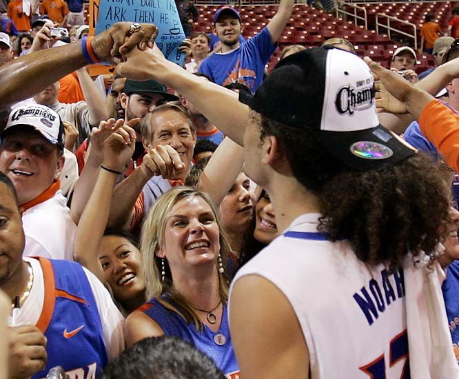 Joakim Noah greets his mother, Cecilia Rodhe (wearing blue dress), following the Gators' 85-77 win over Oregon in the Elite Eight on Sunday.