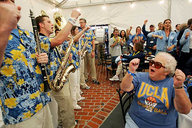 Ethel Cullom, a member of UCLA's Class of 1966, sings the school fight song during a spirit rally with the UCLA Varsity Band on Thursday in San Jose, Calif.