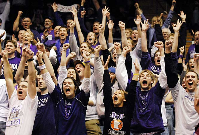 Winona State fans let out a scream as their team pulls ahead out a tight 90-85 overtime victory in the NCAA Division II semifinals against on Thursday.