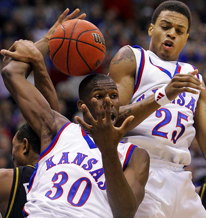 The Jayhawks (30-4) won both the Big 12 regular-season and tournament titles and have one of the nation's deepest and most talented teams led by Julian Wright (30) and Brandon Rush (25).