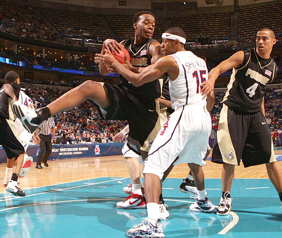 Carl Landry (left) had 21 points and 13 rebounds as Purdue advanced to the second round for the first time since 2003.