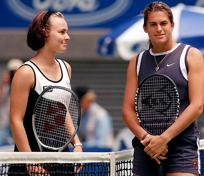 "After being quoted as saying of fellow pro Amelie Mauresmo (picturd at right, with Hingis), ""She travels with her girlfriend, she is half a man."":    ""A half-man? Who would say that?  She's a girl, she's playing tennis ...  She has got a lot of topspin and it's not ... that she is a man but she plays really like a man, the way she plays. That's what we were saying."""