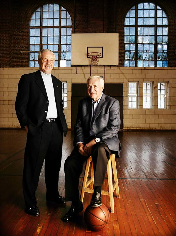 "Frakes' take:<br><br> ""Here are two innovators with ties linking straight back to James K. Naismith. North Carolina coach Roy Williams poses with his mentor, former coach Dean Smith. The two have changed the way the game is played while upholding its traditions. I wanted to bring that home with an old-school look, so we shot this portrait in Woollen Gym, the oldest gym on Carolina's campus."" <br><br>Shot with Canon 1Ds"