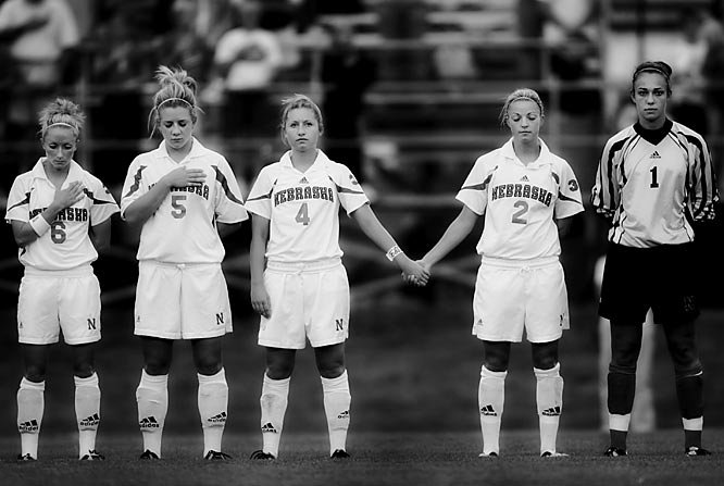 "Frakes' take:<br><br> ""This was a tough image to make. I grew up in Nebraska and have strong feelings for the state. The Cornhuskers women's soccer team lost Jenna Cooper (""Coop"" to her teammates)  in 2004 when she was killed by gunfire (not directed intentionally at her). The team honors her memory by leaving her spot open during the playing of the national anthem.""<br><br> Shot with Canon 20D"