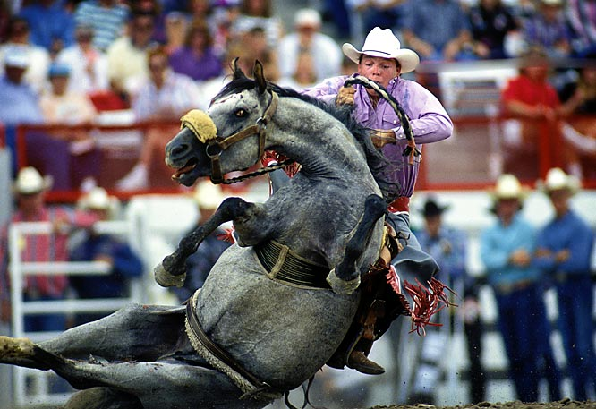 "Frakes' take: <br><br>""At the Granddaddy of them all -- Cheyenne Frontier days -- there is a ground-level bunker that allows you to be right in the middle of the action.""<br><br> Shot with Canon EOS 1N"