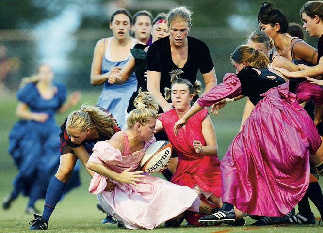 "Frakes' take: <br><br>""I only got to see the last seven minutes of an exhibition rugby game in Gainesville, Fla., between Florida and Southern Florida, but it was enough. The women played the game wearing old prom dresses to raise money for breast cancer research.""<br><br> Shot with Canon EOS 1D"