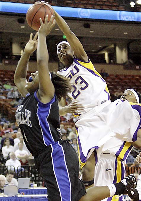 LSU's Allison Hightower blocks a shot by Kyla Jones as Bob Starkey picked up his first win as interim head coach.