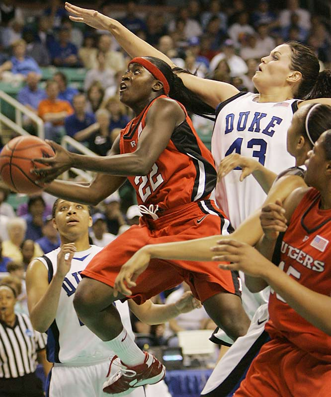 Matee Ajavon (22) drives past Duke's Alison Bales (43) in the first half.