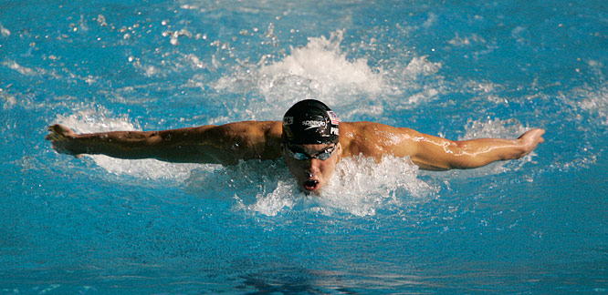 Displaying his usual powerful stroke, Michael Phelps  glides through the pool in the Mens 200M Butterfly semifinal.