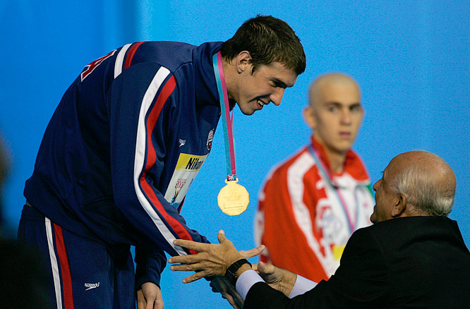 Michael Phelps receiving his third gold medal in as many finals, this time for his world record in the 200M Individual Medley.