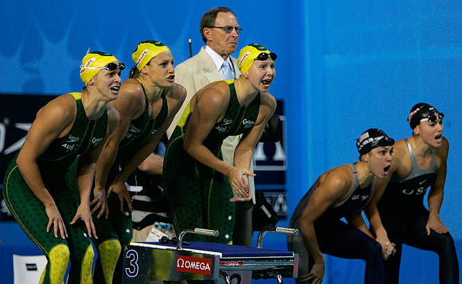 The Australian and U.S. 4x100m freestyle relay teams shout encouragement during the final leg. Australia took gold with the U.S. second and Netherlands in third.