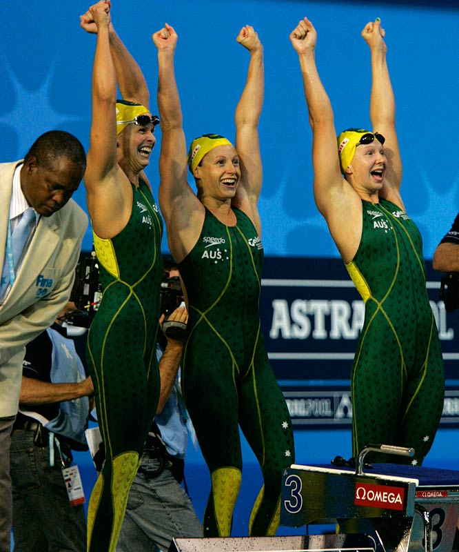 Melanie Schlanger, Shayne Reese and Libby Lenton of Australia celebrate during the women's 4x100m freestyle relay final