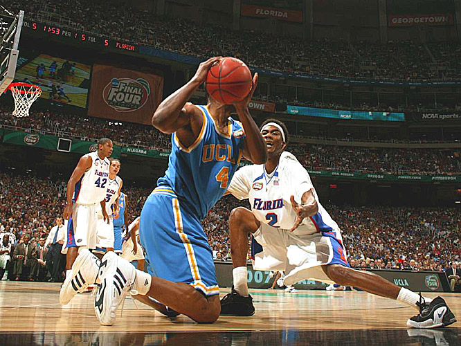 UCLA's Arron Afflalo looks for help as Florida's Corey Brewer defends.