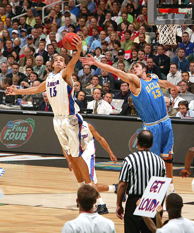 Joakim Noah and UCLA's James Keefe fight for a rebound. Noah finished with 11 boards to lead the Gators.