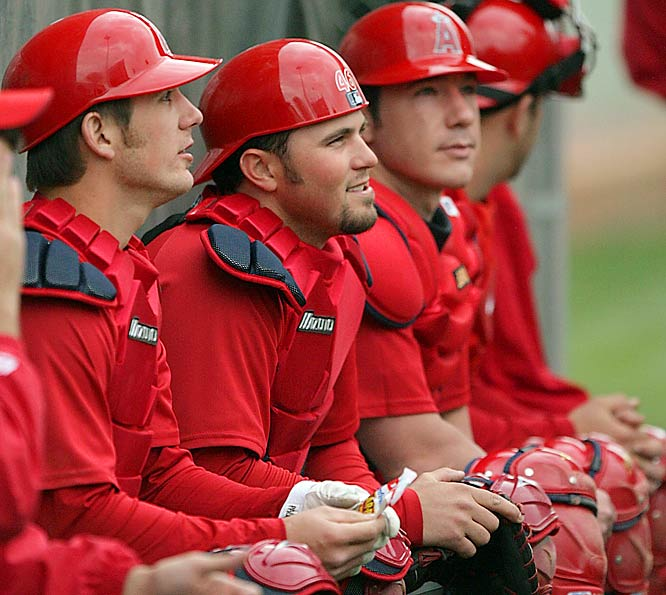 Catchers (from left) Jeff Mathis, Bobby Wilson and Brent Del Chiaro chat with Angels pitchers.