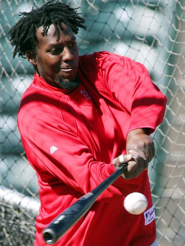 Vladimir Guerrero hones his violent batting stroke.