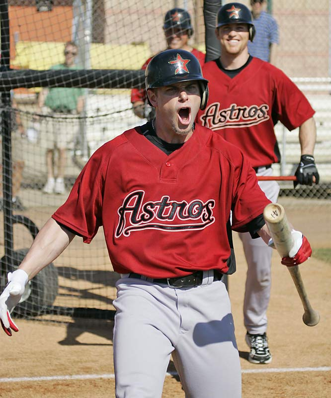 Brandon Backe reacts after scoring points in a bunting contest as teammate Brad Lidge looks on.